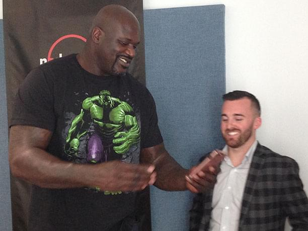 Shaquille O'Neal and Austin Dillon Check out the new iPhone.