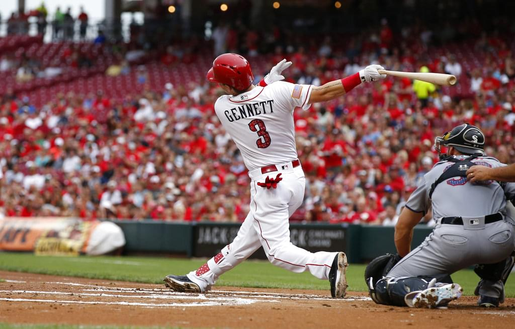 5a510f6c1 Cincinnati Reds  Scooter Gennett (3) hits a two-run home run off Chicago  White Sox starting pitcher Lucas Giolito during the first inning of a  baseball game ...