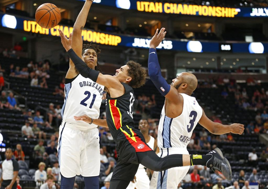 ea0066e2c619 FILE – Atlanta Hawks guard Trae Young (11) lays the ball up as Memphis  Grizzlies  Deyonta Davis (21) and Jevon Carter (3) defend during the first  half of an ...