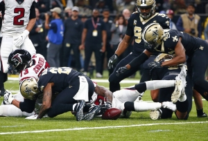 356be2fdc New Orleans Saints scramble on the turf to pick up a fumble by the Atlanta  Falcons in the first half of an NFL football game in New Orleans