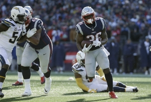 New England Patriots running back Sony Michel heads for the goal line and  his second touchdown during the first half of an NFL divisional playoff  football ... d2358c5ed