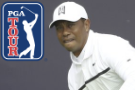 The Latest: Woods tees off hoping to make the Open cut
