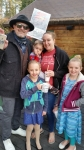 Sophia and the family with Z-Rock's Tim Buc Moore during Wake the Buc Up round 2 at Juice and Java in Paradise