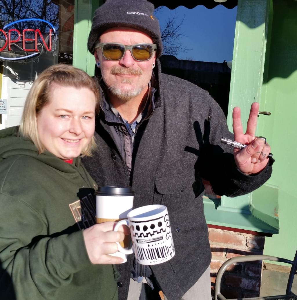 Tim Buc Moore poses with Z-Rock doodle mug recipients at Wake the Buc Up in Oroville at Mugshots Coffee House