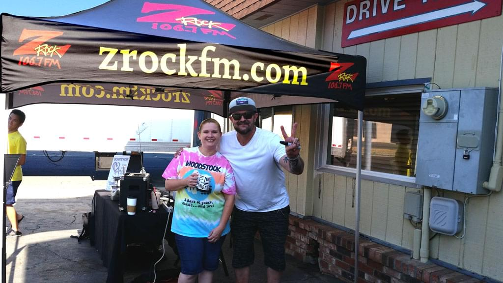 Tim Buc Moore with listener and Z-Rock doodle mug at Lots 'A Java in Oroville California for Wake the Buc Up August 16th 2018