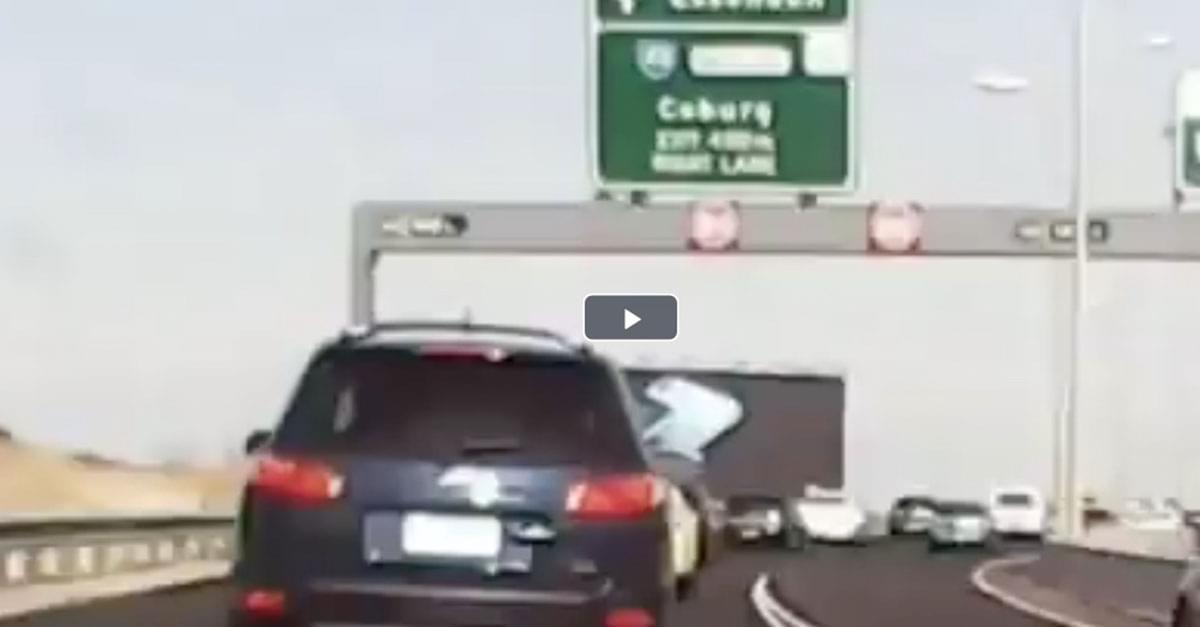 Watch: Large Freeway Sign Falls on Moving Vehicle