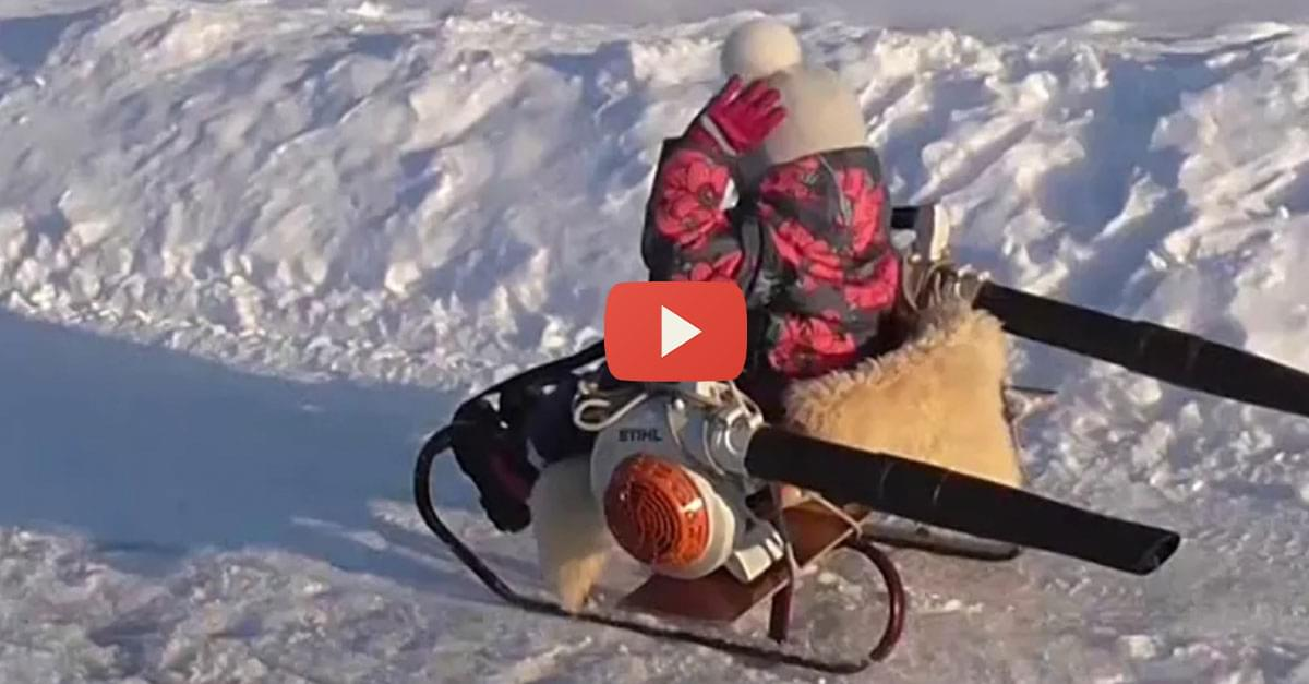 Watch: Dad creates snowmobile from a sled and leaf blowers