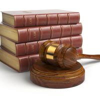 Gavel and lawyer books isolated on white. Justice, law and legal
