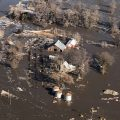 The Latest: Getting aid to flood victims is priority