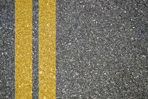 Pattern of asphalt texture with twoyellow lines
