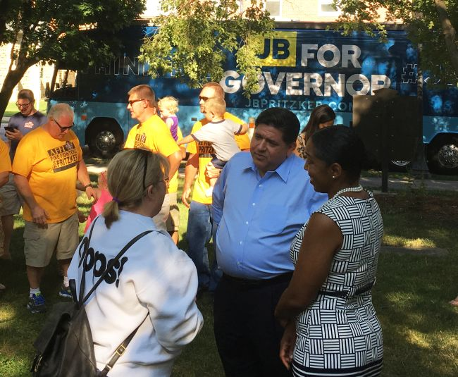 Governor candidate J.B. Pritzker talks to people at Washington Park in Ottawa.