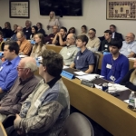 Area high school students sit with County Board during solar energy farm votes