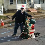 Want a bad pothole fixed?  Decorate it for the Holidays!