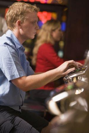 Man playing slot machines