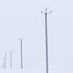 Power companies continue repairing and replacing poles and wires after ice storm