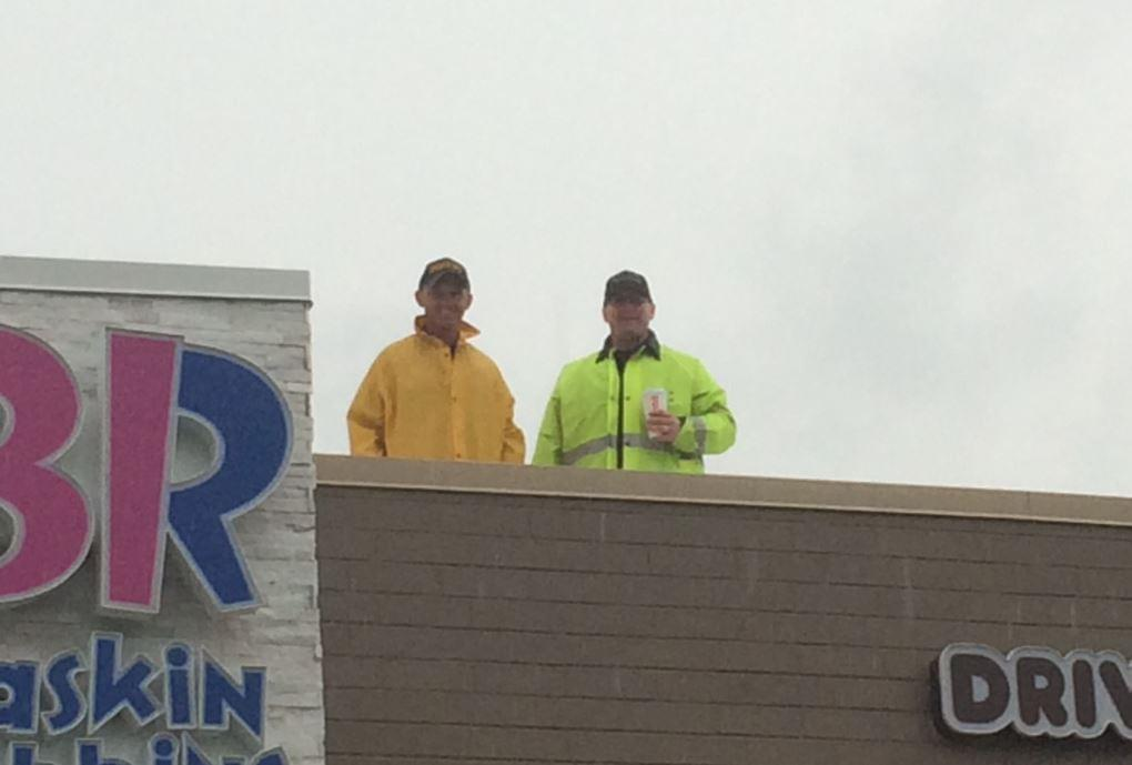 Rain Could Not Stop the Cop on a Rooftop