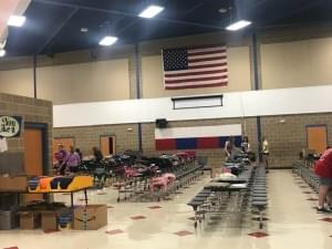 Volunteers Working Hard Setting Up Tools for Schools at Reagan Middle School
