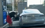 [VIDEO] Woman Tries to Put Gas in Her Electric Car