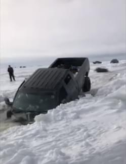 A Lake in Wisconsin Swallows a Truck