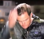 Reporter Doesn't Know He's On-the-Air, Spits in Hand, Slicks Back his Hair