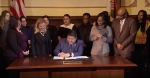 Pritzker restores state employee wage increases, signs pay-equity order