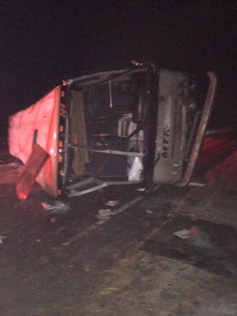 Bus carrying UW students rolls onto side on icy I-90
