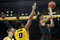 Trimble, 25th-ranked Terrapins outlast Iowa 84-76