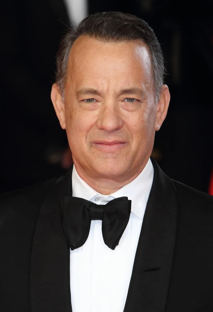 Tom Hanks improvs as audience member becomes ill during performance