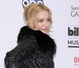 Madonna poses provocatively to promote her new album
