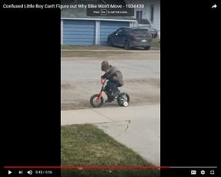 Viral Video of the Day: Little Boy Can't Figure Out Why Bike Won't Move
