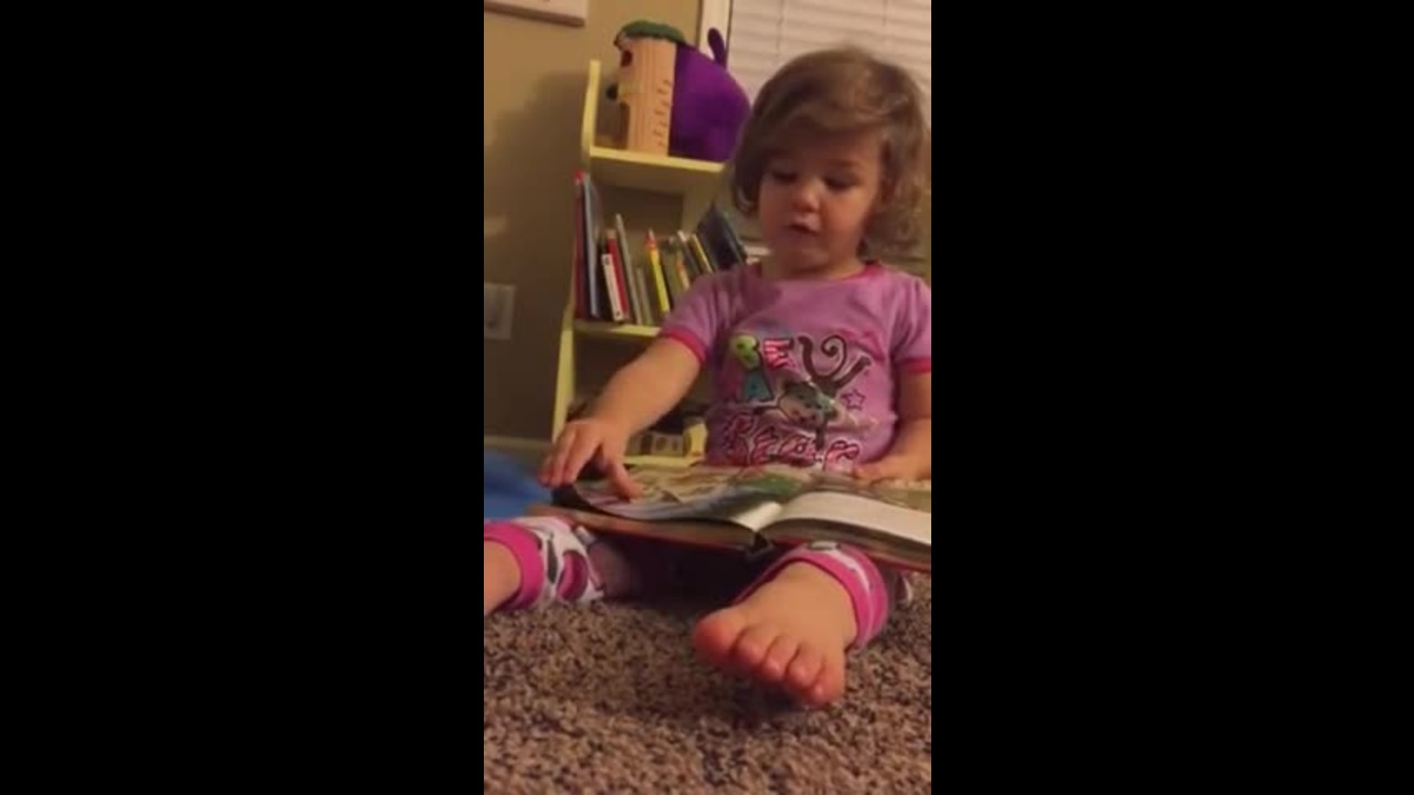 Adorable Girl Reads Bedtime Story to Her Dad
