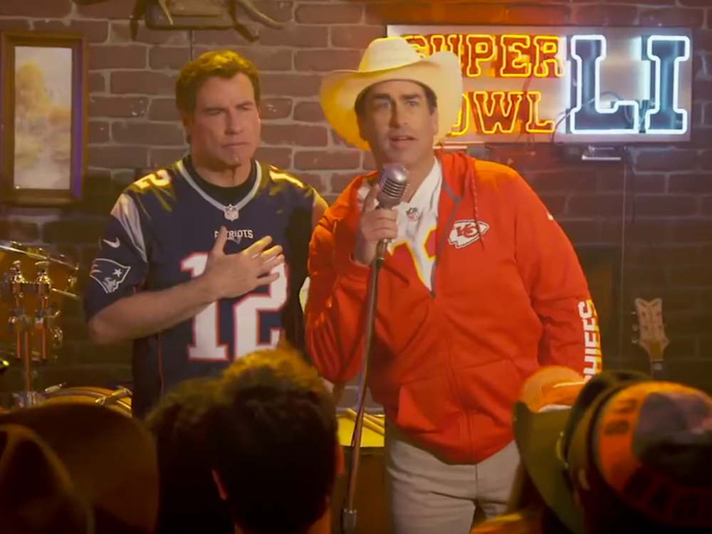 """Watch Comedian Rob Riggle's Super Bowl Parody of """"Friends in Low Places"""" With Pals John Travolta, Weird Al, Ken Jeong and More"""