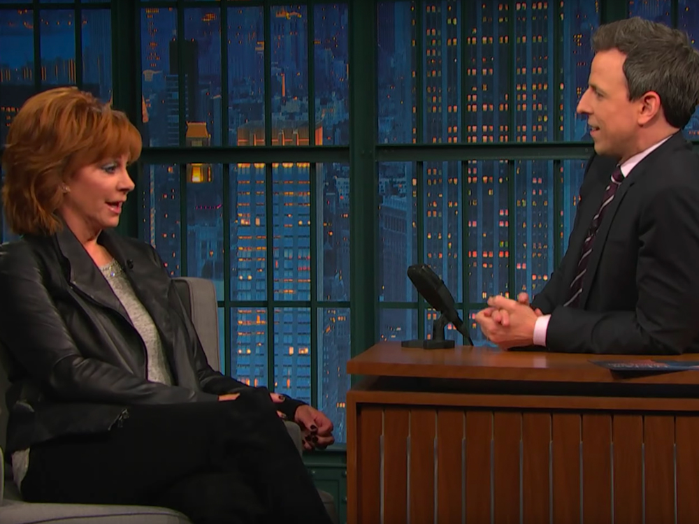 """Late Night With Seth Meyers"" Reveals Reba McEntire Was Born With a Proper English Accent [Watch]"