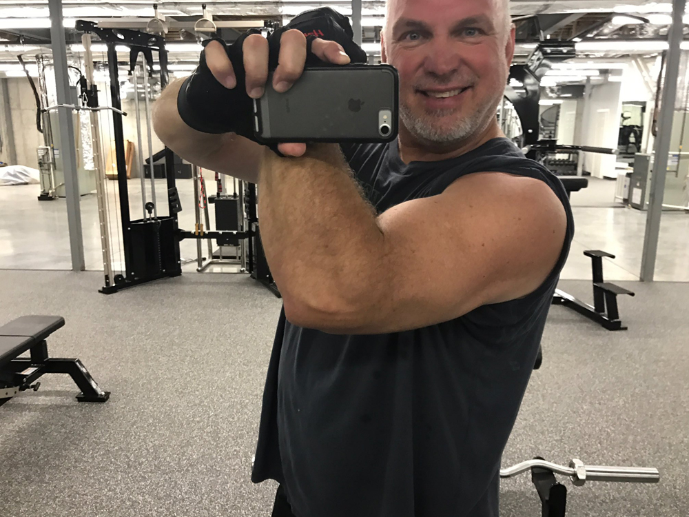 Tim McGraw and Garth Brooks Flex Their Guns for a Good Cause