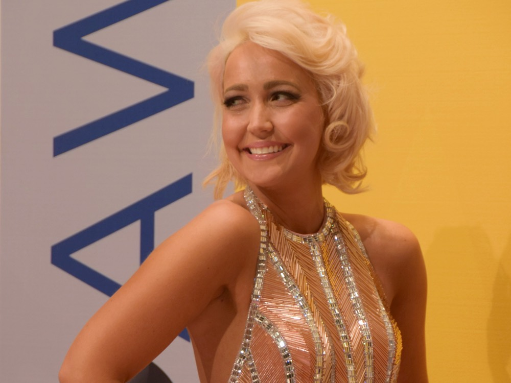 Meghan Linsey Issues Statement After Kneeling During National Anthem Performance