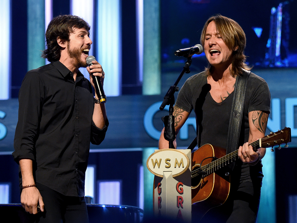 "Going Once, Going Twice: Watch Keith Urban & Chris Janson Cover John Michael Montgomery's ""Sold"" at the Opry"