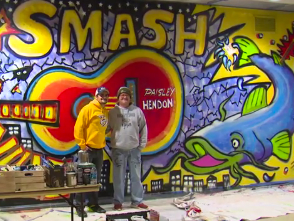 6bc04fcd00c8b Brad Paisley Teams With Local Artist to Paint Mural Inside Nashville s  Bridgestone Arena