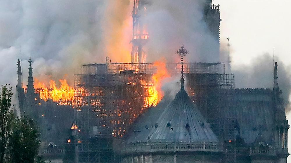Notre Dame Cathedral fire: 'Entire fire is out,' official says; authorities assess damage