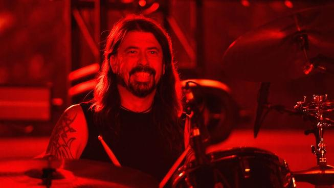 Dave Grohl has fun with drunk fan on stage