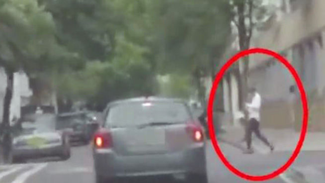 Distracted Pedestrian Walks into Traffic, Gets Angry with Driver