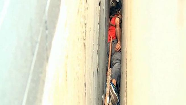 Man Stuck Between Buildings for 3 Hours After Falling from Roof