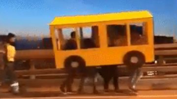 People Dressed As Bus Attempt To Cross Vehicle Only Bridge