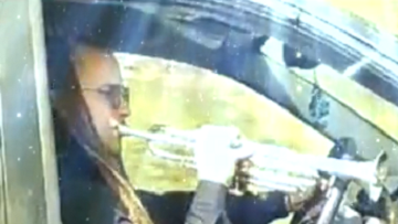 Driver Plays Trumpet Behind The Wheel