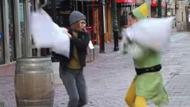 Elf Challenges Strangers to Pillow Fights