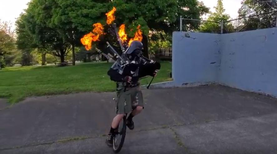 Flaming Bagpipe-Playing Darth Vader On a Unicycle