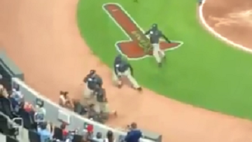 Fan Gets Tackled After He Corners Himself At Braves Game