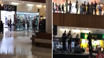 Band Plays As Mall Floods