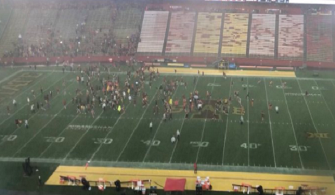 Iowa State Students Rush Field During Weather Delay