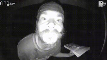 Man caught on camera going in for repeated licks of doorbell