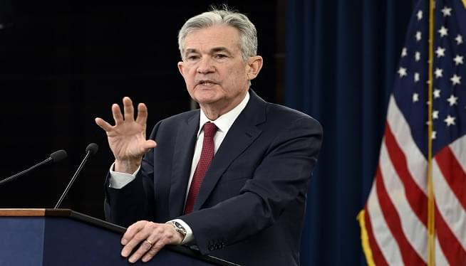 Powell Says Fed Will Aid Economy, But Trump Escalates Attack